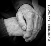 wrinkled hands of an old man. a ... | Shutterstock . vector #622702445
