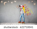 kid with toy cardboard rocket.... | Shutterstock . vector #622710041