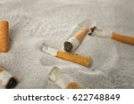 Cigarette Butts On Sand