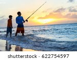 Father And Son Fishing Together ...