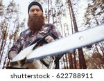 Small photo of Bearded logger chopping trees