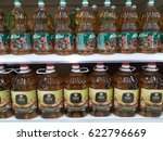 Small photo of Klang , Malaysia - 13th April 2017 ; Plastic bottle of cooking oil branded Alif and Sri Murni on the shelf in supermarket at Klang , Malaysia.