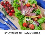 ham with salad on a wooden plate | Shutterstock . vector #622798865