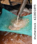 Small photo of Sago Making, Indonesia. Sago is a starch extracted from the spongy center, or pith, of various tropical palm stems. It is a major staple food for the lowland peoples of New Guinea and the Moluccas.