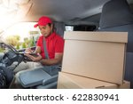 delivery man in red uniform in... | Shutterstock . vector #622830941