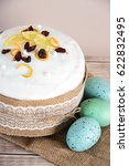 Small photo of Easter composition of sweet bread, paska and eggs on wooden background. Orthodox kulich. Holidays breakfast concept