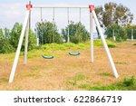 children swing at playground | Shutterstock . vector #622866719