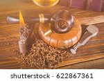smoking pipe and notebook on... | Shutterstock . vector #622867361