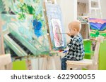 a child draws a picture paints... | Shutterstock . vector #622900055