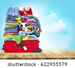 suitcase full of clothes  open... | Shutterstock . vector #622955579