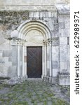 Small photo of Gate of the romanesque church in Ócsa, Hungary