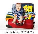 baby in travel suitcase  kid... | Shutterstock . vector #622990619