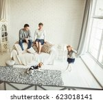 happy parents watched their... | Shutterstock . vector #623018141