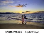 senior couple walking on a maui ... | Shutterstock . vector #62306962