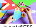 small child makes paper crafts... | Shutterstock . vector #623074535