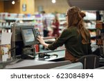 Back View Photo Of Cashier...