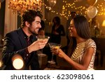 couple make toast as they... | Shutterstock . vector #623098061