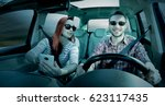 two lovers in car interior and... | Shutterstock . vector #623117435