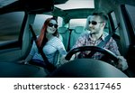 two lovers in car interior and... | Shutterstock . vector #623117465
