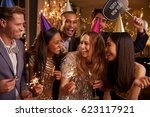 group of friends celebrating at ... | Shutterstock . vector #623117921