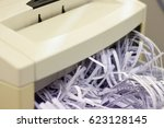 Small photo of Office shredding machine with full bin. Concept of complete destruction, covering tracks, document processing, gone beyond repair, difficult investigation