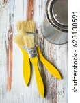 three brushes lie on a light... | Shutterstock . vector #623138591
