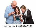 Girl And Grandparents Browsing...