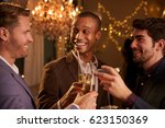 male friends make toast as they ... | Shutterstock . vector #623150369