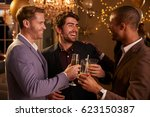 male friends make toast as they ... | Shutterstock . vector #623150387