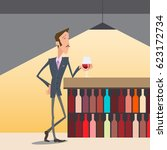 a man with a glass of wine at... | Shutterstock .eps vector #623172734