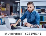 young man  hipster using his... | Shutterstock . vector #623198141