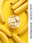 Small photo of Sweet bananas on the yellow background
