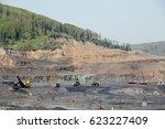 excavator  digging for brown... | Shutterstock . vector #623227409
