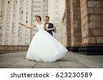 groom holds bride like a dancer ... | Shutterstock . vector #623230589