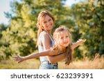 cute little girl enjoying... | Shutterstock . vector #623239391