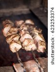 pork meat grilled on skewers.... | Shutterstock . vector #623253374