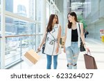 friends walking in shopping... | Shutterstock . vector #623264027