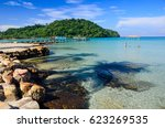 Small photo of Enjoin a good summer time on the beach with clear water and blue sky at Bang Bao Beach on Koh Kood islands in Gulf of Thailand