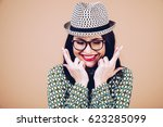 Small photo of Finger crossed for good luck. Lucky girl portrait. Successful exam concept. Lucky girl in hat.