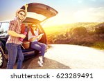 car trip and sunset time  | Shutterstock . vector #623289491