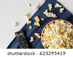 popcorn with remote control on... | Shutterstock . vector #623295419