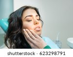 young woman having toothache.... | Shutterstock . vector #623298791