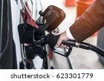 businessman refuel at the gas... | Shutterstock . vector #623301779
