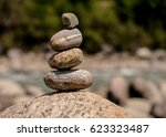 stones stacked one above the... | Shutterstock . vector #623323487
