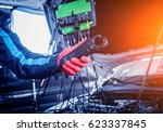 auto mechanic uses a voltmeter... | Shutterstock . vector #623337845