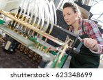 woman operating industrial... | Shutterstock . vector #623348699