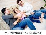 family lying on floor   Shutterstock . vector #623356961