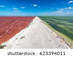 dirt road with red water on one ...   Shutterstock . vector #623394011