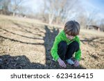 child picking leaves from the... | Shutterstock . vector #623416415