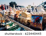 Small photo of FRANKFURT, GERMANY - AUGUST 23, 2015 : Closeup of many ceramics decorations exposed for sale on a table in a haggle in Frankfurt, Germany .